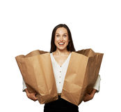 Beautiful excited woman with paper bags Stock Images