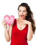 Beautiful excited woman pointing at love heart Stock Image