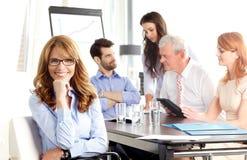 Beautiful executive businesswoman at meeting. Stock Images