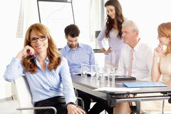 Beautiful executive businesswoman at meeting. Stock Images