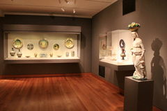 Beautiful exhibits on stands and in glass cases,Cleveland Art Museum,Ohio,2016. Gorgeous exhibits with historic masterpieces on stands and in glass cases stock image