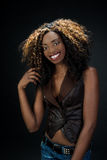 Beautiful exotic African American woman with a lovely natural sm Stock Images