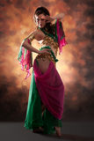 Beautiful exotic belly dancer woman. A rot-green costume stock photography
