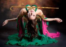 Beautiful exotic belly dancer woman. A rot-green costume stock photo