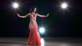 Beautiful exotic belly dancer woman dancing on stock video