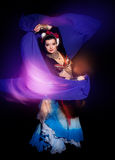Beautiful exotic belly tribal dancer woman with blue shawl Stock Images