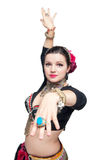 Beautiful exotic belly tribal dancer woman. Focus on hand Stock Image