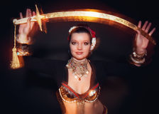 Beautiful exotic belly tribal dancer woman with sword Stock Images
