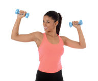Beautiful and exotic hispanic woman holding hand weights training in fitness concept. Corporate portrait for gym advertising of young beautiful and exotic Royalty Free Stock Image