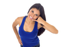 Beautiful and exotic latin woman doing call on phone sign with her hand isolated on white Stock Photos
