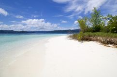 Beautiful exotic and wild  beach of white sand in raja ampat arc. Hipelago, west papua Royalty Free Stock Photography