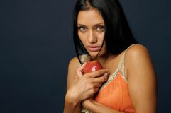 Beautiful exotic woman with apple. Beautiful Exotic Woman is eating and holding the apple Stock Photos