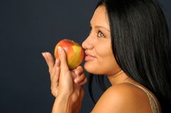 Beautiful exotic woman with apple Stock Photos