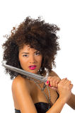Beautiful exotic young tribal woman holding a dagger Royalty Free Stock Image