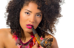Beautiful exotic young tribal woman holding a pipe Stock Photo