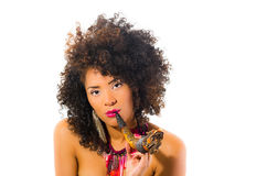 Beautiful exotic young tribal woman holding a pipe Royalty Free Stock Images