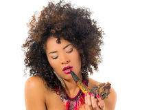 Beautiful exotic young tribal woman holding a pipe Royalty Free Stock Photo