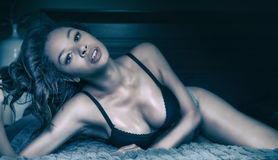 Beautiful exotic young woman with dark hair Stock Photo