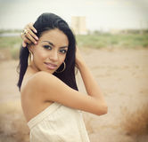 Beautiful exotic young woman. Beautiful exotic elegant young woman standing outside Stock Photos