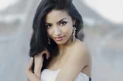 Beautiful exotic young woman. Beautiful exotic elegant young woman standing outside Royalty Free Stock Image