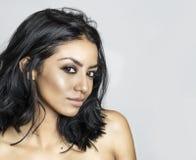 Beautiful exotic young woman long hair. Beautiful exotic young woman, gorgeous face and eyes Stock Photo