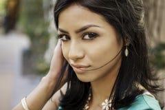 Beautiful exotic young woman long hair. Beautiful exotic young woman, gorgeous face and eyes Royalty Free Stock Image