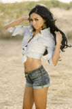 Beautiful exotic young woman long hair. Beautiful exotic young woman wearing denim jean shorts and top - posing in Arizona desert, USA Royalty Free Stock Images