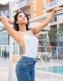 Beautiful exotic young woman looking out. Over balcony Royalty Free Stock Image