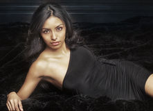 Beautiful exotic young woman. Portrait of a beautiful exotic young woman wearing black dress with gorgeous face Royalty Free Stock Photos