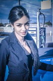 Beautiful exotic young woman pumping gas Royalty Free Stock Images