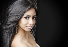 Beautiful exotic young woman with shiny hair Royalty Free Stock Image