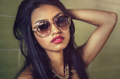 Beautiful exotic young woman wearing sunglasses Royalty Free Stock Photos
