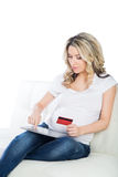 Beautiful expectant mother with credit card to do shopping Stock Photo