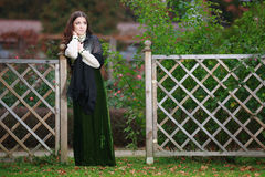 Beautiful expectant woman. In autumn park stock image