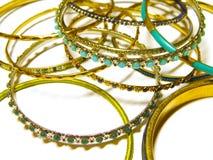 Beautiful expensive gold bracelets isolated on white Stock Photo
