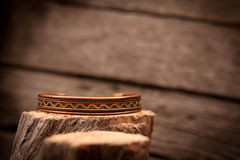 Beautiful expensive gold bracelets on wooden Stock Image
