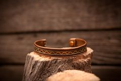 Beautiful expensive gold bracelets on wooden Stock Photos