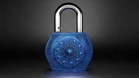 Beautiful expensive looking small lock, jewellery for rich people. Beautiful expensive looking small blue lock, close up, isolated on a dark grey background Stock Photography