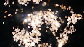 Beautiful explosions of fireworks in the night sky bokeh stock footage