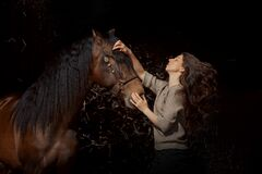 Beautiful expression young woman portrait with spanish horse