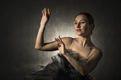 Beautiful expressive ballerina in the role of a black swan Stock Photo