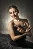 Beautiful expressive ballerina in the role of a black swan Stock Photos