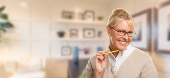 Beautiful Expressive Student or Businesswoman with Pencil in Office Royalty Free Stock Photography