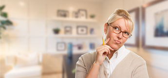 Pensive Teacher, Student or Businesswoman with Pencil in Office Stock Images
