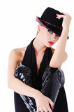 Beautiful expressive woman. Elegant glamour girl in black clothes with stylish fashion hat Royalty Free Stock Photos