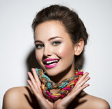 Beautiful expressive woman with bright  jewelry and Stock Image