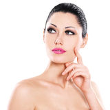 Beautiful expressive woman cares of the skin face Stock Images