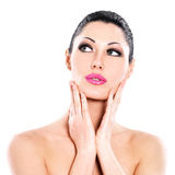 Beautiful expressive woman cares of the skin face Royalty Free Stock Images