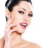 Beautiful expressive woman cares of the skin face Stock Photos