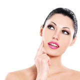 Beautiful expressive woman cares of the skin face Stock Photo